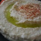 "Authentic Middle Eastern Hummus (Chummus) - ""Authentic chummus is very different and SO much tastier than its American counterpart. This chummus is creamy and delicate in taste rather than overpowered with garlic or thick and pasty. It is eaten warm, fresh, and as a whole meal spread out in a dish and drizzled with fresh olive oil. It is scooped up with pita, raw onion slices, or just a fork. Do NOT use canned chickpeas (garbanzo beans)!"""