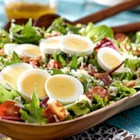 BLT Salad with Sweet Onion Vinaigrette - The secret to this recipe is the grated eggs, which adds creaminess to this simple salad, finished off with sweet onion vinaigrette. It is sure to become your salad go-to!