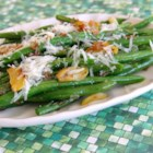 Garlicky Green Beans with Shallot - This recipe seasons green beans with shallot and garlic and then adds Parmesan cheese for a great side dish suitable for Thanksgiving dinner.