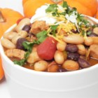 Slow Cooker Chicken Chili - Using a slow cooker makes preparing this chicken chili with black beans, Cannellini beans, and sour cream as easy as you'd like!