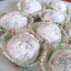 Meemaw's Bourbon Balls - A little bit of bourbon goes into these balls of crushed vanilla wafers and pecans. Roll them in confectioners' sugar and coconut for added layers of flavor.