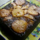 Persimmon Upside Down Cake - Persimmon pulp flavors the spice cake base, while sliced persimmons decorate the top of this gorgeous fall dessert.