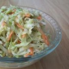 Sweet Restaurant Slaw - Starting with prepared coleslaw mix this recipe for a creamy coleslaw delivers a bit of tang through the use of vinegar, making it a perfect accompaniment for fried chicken, burgers, or fried fish.