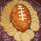 Football Cheese Ball - Get ready for game time with this creamy and spicy cheese ball made with cheddar, green onions and taco seasoning.