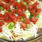 Quick and Easy Dip - This 4-layer Mexican-style dip can be made in just a few minutes and is usually eaten just as quickly. Serve with corn tortilla chips.