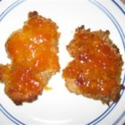Orange Cracker Apricot Chicken - This recipe makes very moist chicken thighs breaded with cracker crumbs and coated in apricot preserves.