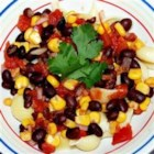 Black Bean and Corn Pasta with Chicken - Great quick dinner, perfect for summer corn leftovers.  Two ears of corn yield one cup of kernels.  Top with shredded cheese.
