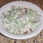 Barb's Broccoli-Cauliflower Salad - A nice crunch in this salad, bacon bits, sunflower seeds, diced broccoli, cauliflower, and onion are tossed with a yummy, slightly sweet and sour dressing and chilled.