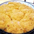 Peach Cobbler II - Fresh peaches are sliced, tossed in sugar and lemon juice, topped with homemade biscuit dough, and baked until the filling is bubbly and the crust is golden brown.