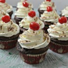 Cherry Coke(R) Cupcakes - Cherry-flavored cola and cherry pie filling add a sweet flavor to chocolate cake mix in this easy cupcake recipe. Top with frosting and a maraschino cherry!