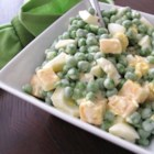 Green Pea Salad With Cheddar Cheese - Nothing but standard stuff in this quick salad recipe. Just mix peas, mayonnaise, egg, cheese, and onion and enjoy it!