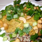 Sweet Thai-Style Chicken Bowl - This Thai-style chicken bowl has a layer of rice topped with sprouts, cashews, and chicken this is drizzled with a mango curry sauce for a one-dish meal for lunch or dinner.