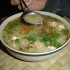 Canja - This is a meaty Brazilian chicken soup made with rice, carrots, tomatoes and diced ham.