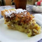 PCP Pie - A rich homemade custard fills this pineapple-coconut-pecan pie.