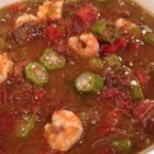 Teddy's Duck Gumbo - Gumbo with a twist! Duck is added to the traditional spicy medley of shrimp, smoked sausage, bell peppers, onions, garlic, celery, and tomatoes to create a rich, hearty dish. Serve hot over white rice, and substitute other poultry for the duck if you wish.
