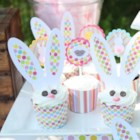 Cute Bunny Cupcakes - Cute Easter bunny cupcakes are decorated with fluffy white coconut and sport pink graham cracker ears, chocolate chip eyes, and pink frosting noses.