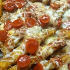 Jan's Loaded Pizza Fries - French fries are topped with pizza sauce, mozzarella cheese, and pepperoni in this recipe for loaded pizza fries perfect as a fun appetizer.