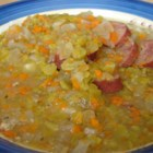 Slow Cooker Split Pea Sausage Soup - Dried split peas and smoked sausages are combined in this slow cooker soup with carrots, potatoes, oregano and garlic powder.  Allow 5 hours cooking time.