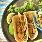 Spicy Turkey Tacos - Transform your leftover turkey into spicy turkey tacos using taco seasoning and jalapeno peppers in a slow cooker; serve in small tortillas.