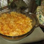 Baked Macaroni and Cheese III - Easy and cheesy Cheddar and Parmesan sauce with elbow macaroni baked to perfection.