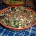 Greek Lentil Salad - Brown lentils with chopped fresh cucumber, tomato, red onion, and crumbled feta cheese with Greek salad dressing, or dressing of your choice.
