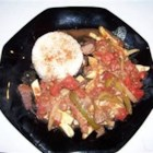 Peruvian Lomo Saltado - This is a traditional Peruvian dish made with sliced beef, hot chiles, and French fries.  It is a very easy dish to make.  I might add that it's very popular with finicky kids and adults as well.