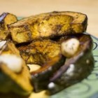 Roasted Acorn Squash -  Acorn squash are so beautiful as is, but even more so when sliced in half and baked. For this flavorful dish, the cooked squash meat is mixed with onions, coriander, nutmeg and garlic, and heated on the stove until hot and delicious.