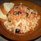 Linguine Pescadoro - A lively simmer of garlic, thyme, tomatoes, olives, clam juice and red pepper flakes makes a flavorful base for fresh shrimp, scallops and baby clams, perfect with hot linguini. Hint: discard any clams that do not open after they simmer.