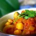 Cholay (Curried Chickpeas) - This is a very flavourful recipe from North India, usually eaten with fried bread like bhatura or puri. I like to serve it over rice for a very filling meal. You can also try it as a quick snack over toasted bread. This recipe is much quicker to make if you use precooked canned beans, but I like to think that the authentic flavour comes from doing it the hard way!