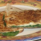 Spinach Whole Wheat Quesadillas - This is a super quick, easy, and light dinner. This also makes a great snack or appetizer. It looks like a lot of spinach at first, but it shrinks down a lot in no time during cooking. Other types of tortillas can be used if whole wheat isn't available. Serve with salsa and sour cream.