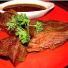 Slow Cooked Venison - This tasty slow cooked venison roast is cooked for hours in a spicy, chile-garlic sauce.