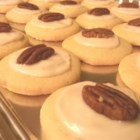 Gram Opal's Sugar Cookies - Enjoy a taste of grandma's cooking with these delightful sugar cookies topped with a light icing and a pecan.