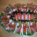 Antipasto Platter - A variety of cheeses and deli meat slices are layered with vegetables, peppers and spices to create a mighty party platter that's filled with exciting flavors and easy on the eyes.