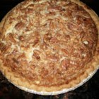 Pecan Surprise Pie - When the pie is prepared, the cheesecake layer goes in first, then a sprinkling of pecans goes on top, followed by a sweet and spiced up egg and corn syrup concoction. When this pie emerges from the oven, the layers are, surprisingly, reversed.