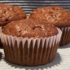Chocolate Zucchini Muffins - Take one recipe for fabulous, spicy zucchini muffins and add a big scoop of cocoa.  Then top the muffins with chocolate chips or streusel and you are in chocolate-zucchini-muffin heaven.