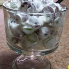 Easy Grape Salad - A colorful, delicious salad of green and red grapes, lightly sweetened with a combination of marshmallow cream and cream cheese, with a crunch from slivered almonds.