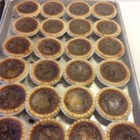 Sandra's Butter Tarts - Home-baked butter tarts are simple and quick to prepare, especially if you are using prepared pastry shells.