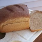 Kid-Friendly Wheat Bread - An easy kid-friendly wheat sandwich bread, especially easy if you have a mixer with a dough hook.  My picky kid even eats the crust!