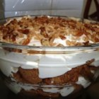 Easy Pumpkin Cream Trifle - Layers of spice cake and pudding are topped with pecans and toffee bits to make this delightful dessert that makes a great addition to any holiday meal.