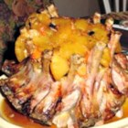 Crown Roast of Pork - Impress all your guests with a crown roast of pork filled with a rice and golden raisin stuffing at your next formal dinner party.