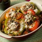 Laurie's Stuffed Peppers - Sweet green peppers stuffed with tomatoes, onion, hamburger, sausage, jalapenos, and rice. Easy and delicious.