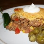 Cowboy Skillet Casserole - Zesty meat, beans, and peppers topped with sweet corn bread.  A great, fast, family pleaser or potluck dish. Depending on the crowd you're trying to please, you may want to jazz it up:  Bulk up the meat mixture with extra veggies, add Cheddar cheese, jalapeno peppers, or chili powder to the cornbread.