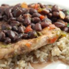 Black Beans and Pork Chops - Six ingredients - pork chops, black beans, salsa, cilantro, black pepper, and olive oil - are all you need to make this quick and delicious dish.