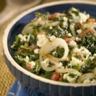 Spinach with a Twist - This is a quick and easy side dish I made up to complement any fish or chicken dish with spinach, diced tomatoes, and that rich Roquefort cheese (any blue cheese will work).