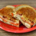 Aidan Special - Rye bread, Swiss cheese, bacon, tomato, and turkey are heated together in this hearty and filling sandwich perfect for cold days and evenings.