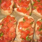 Bruschetta I - Fresh tomatoes, parsley, chives, garlic and basil create this beautiful, tasty dish.  Add balsamic vinegar if you like.  Serve on toasted French bread with pesto, or enjoy it all by itself.
