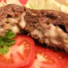 Game Day Hamburgers - First the ground beef is mixed with onion soup mix and formed into nice thick patties. Then shredded potato, Swiss cheese, and mushrooms are combined, stuffed into each patty, and sealed for a nifty surprise with that first bite.