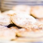 Welsh Cakes - We attended a county fair in Wales and the ladies of the local church were baking and selling these.  We asked for the recipe and they graciously shared it with us.  This has been converted to US  standard.  They are delicious and not as sweet as some of our style cookies. Dried currants can be used in place of the raisins.