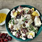 Leftover Thanksgiving Salad - Leftover Thanksgiving turkey metamorphoses into a tasty chopped salad with assistance from ham, dried cranberries, fresh basil, and hard-cooked egg tossed in a light mayonnaise dressing.