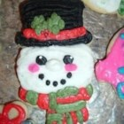 Christmas Cut-Out Cookies - Sugar cut-out cookies with a hint of anise flavoring. Crisp and white, these cookies are excellent for frosting and decorating.